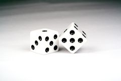Dice. Closeup of black and white dice. Meticulously clean, shot in studio light on a white background Royalty Free Stock Photos