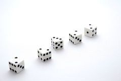 Dice. Five dices on a white background with different numbers Royalty Free Stock Image
