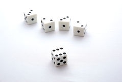 Dice 3. Five dice on a white background with one in the center Royalty Free Stock Image