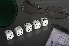 Dice. Five dice on a black glass Stock Images