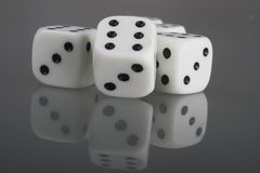 Dice. Five dice on a black glass Royalty Free Stock Image