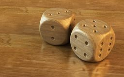 Dice 3d rendering. 3d rendering of the dice on the wooden table stock illustration