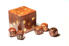 Dice. Six small dice and one big die on the white background stock photo