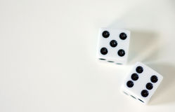 Dice. Top view of a pair of white Dice over a white background showing a roll of eleven Stock Photography