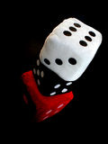 Dice. Red, white and black dice up in a column Stock Photo