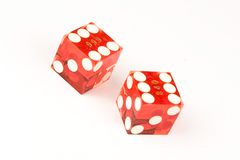 Dice. Two casino dice showing the numbers 6 and 6 isolated on a white background Stock Image