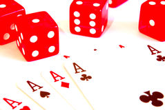 Dice and ace. Five red dice and five ace on a white isolated background Royalty Free Stock Photos