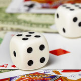 Dice against cards and money. Dice against the cards and money close-up Stock Photos