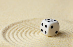 Dice with against yellow sand Royalty Free Stock Photos