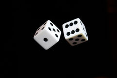 Dice in Air. Dice appearing to be thrown in the air Royalty Free Stock Photos