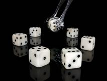 Dice and ancient silver nippers. Royalty Free Stock Photography