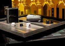 Dice, Backgammon & Bottles (2). Gambling Club Scene with Backgammon board with bottles in Background Royalty Free Stock Photography