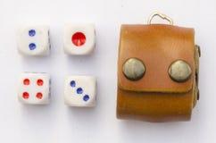 Dice and bag put dice Stock Photo
