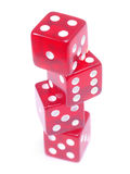 Dice Balancing. Red balancing dice isolated on white Background Royalty Free Stock Image