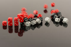 Dice bar chart falling apart. Bar chart made of 6 sided dices falling apart royalty free stock image