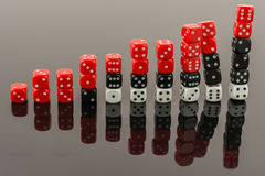 Dice bar graph falling apart. Bar graph made of 6 sided dices falling apart Stock Images