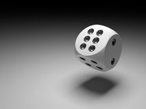 Dice in black. A rolling dice with a nice soft shadow Stock Photos