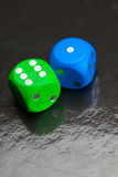 Dice on  black background Stock Photography