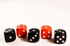 Dice. Black and red dice on a row Royalty Free Stock Photos