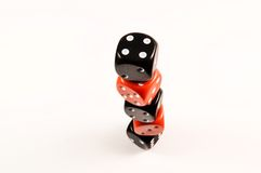 Dice. Black and red dice on a tower Stock Image