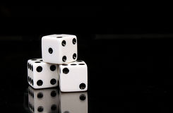 Dice on Black. Three stacked die isolated on black background Stock Image