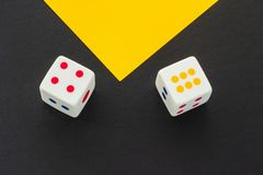 Dice on a black and yellow background stock images