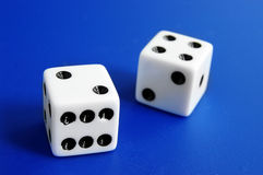 Dice on blue Stock Photo