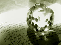 Dice on a book Stock Images