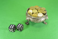 Dice and bowl on three lions feet Royalty Free Stock Image
