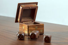 Dice box. Wooden dices for jamb game on a wooden table Royalty Free Stock Photography