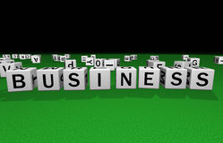Dice business. Dice on a green carpet making the word business Royalty Free Stock Photos