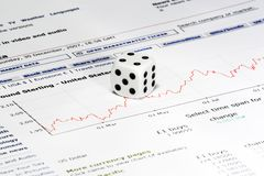 The dice on business document. With diagram Stock Images