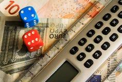 Dice and calculator Stock Photos