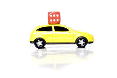 Dice on the car. Concept on white background Stock Images