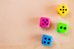 Dice on the cardboard background Royalty Free Stock Photos