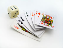 Dice and Cards. Card set next to a miniature dice Stock Images