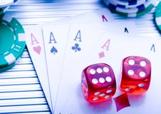 Dice on cards Royalty Free Stock Photos