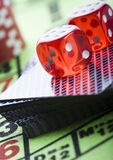 Dice on cards Royalty Free Stock Image