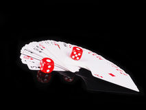 Dice, cards on a black background. concept of gambling Royalty Free Stock Images
