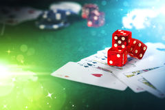 Dice on casino gamble table with colorful bokeh lighting effect. Royalty Free Stock Photo