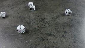Dice cast on concrete stock video