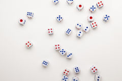 Dice of chance. The dice fall on white paper background, concept for business risk, chance, good luck or gambling stock images
