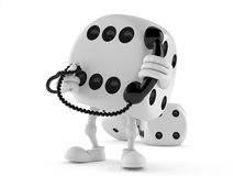 Dice character holding a telephone handset. On white background Royalty Free Stock Photos