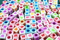 DICE CHARACTERS IN MANY COLORS Stock Photo