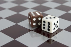 Dice in checkerboard Stock Photography