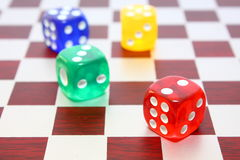 Dice on chess board royalty free stock photos