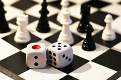 The dice and chess, children`s play Royalty Free Stock Photo