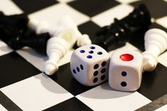 The dice and chess, children`s play Stock Image