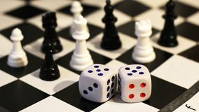 The dice and chess, children`s play Stock Images