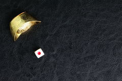 Dice and Chinese gold Royalty Free Stock Photography
